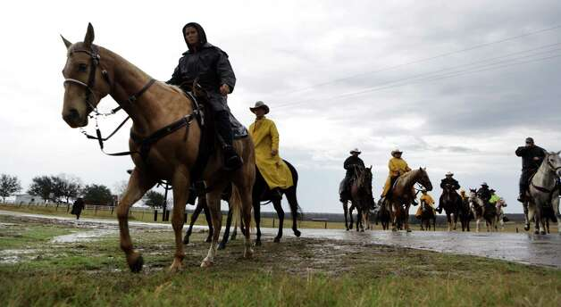 Members of the South Texas Trail Ride make their way along US Highway 181, which started in Falls City today, Wednesday, Feb. 6, 2013, and reached Floresville. Photo: Bob Owen, San Antonio Express-News / © 2012 San Antonio Express-News
