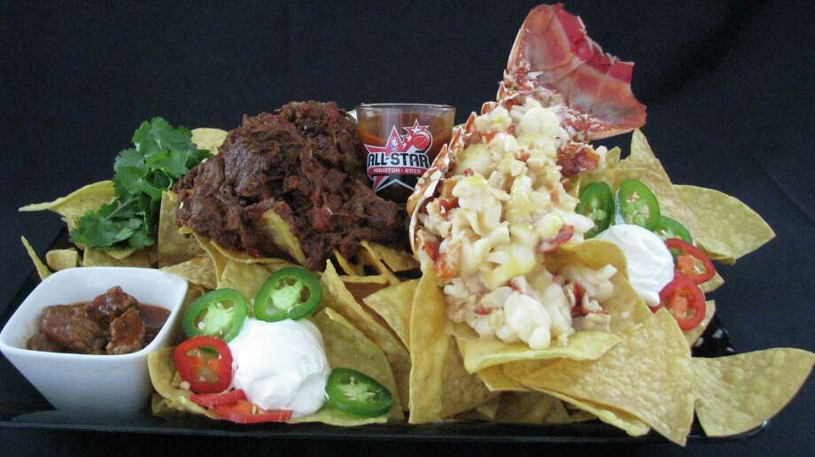 Surf and Turf Nacho planned for the NBA All-Star game at Toyota Center. Super Nacho Surf N? Turf: Big enough for two and topped with lobster and ribeye Texas Chili, homemade seafood bisque cheese sauce, sour cream, cilantro crème and green onions  $48 (Big enough to share) Main Entrance Photo: --