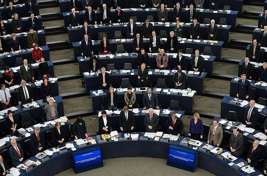 "MP's observe a minute of silence after Tunisian President Moncef Marzouki adressed his speech to the European Parliament  in Strasbourg, eastern France on February 6, 2013.  Marzouki denounced ""the odious assassination"" of his friend and opposition leader Chokri Belaid in an impassioned speech Wednesday that brought tears to the eyes of Europe's politicians. Prominent Tunisian opposition leader Chokri Belaid was shot dead outside his home in Tunis on Wednesday, sparking angry protests by his supporters and attacks on offices of the ruling Islamist Ennahda party. AFP PHOTO / PATRICK HERTZOGPATRICK HERTZOG/AFP/Getty Images Photo: Patrick Hertzog, AFP/Getty Images"