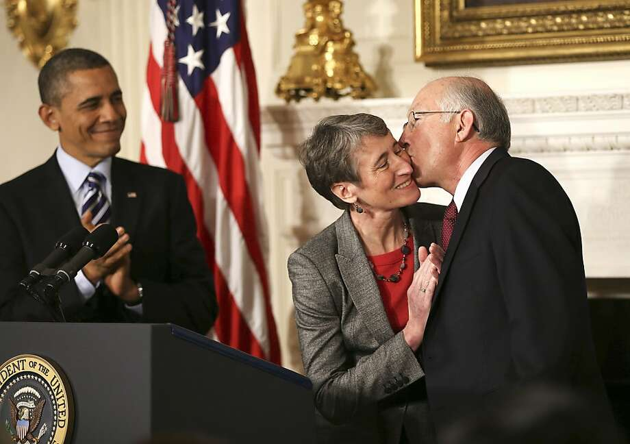 President Obama applauds as Interior Secretary Ken Salazar kisses Sally Jewell, who has been nominated to replace him during the president's second term. Jewell is CEO of REI. Photo: Doug Mills, New York Times