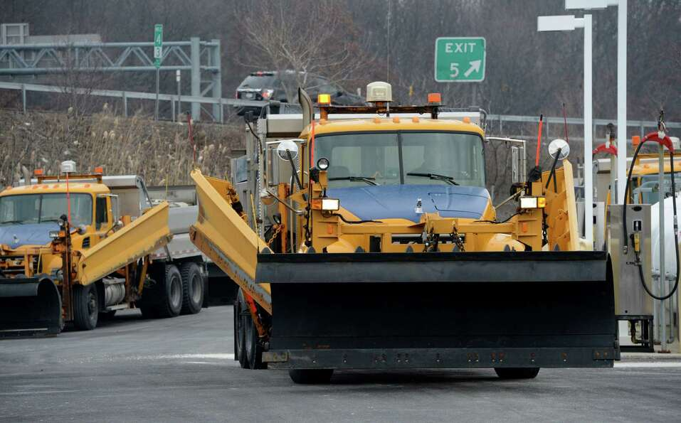 A New York State Department of Transportation snow plow leaves Wednesday morning Feb. 6, 2013 from t