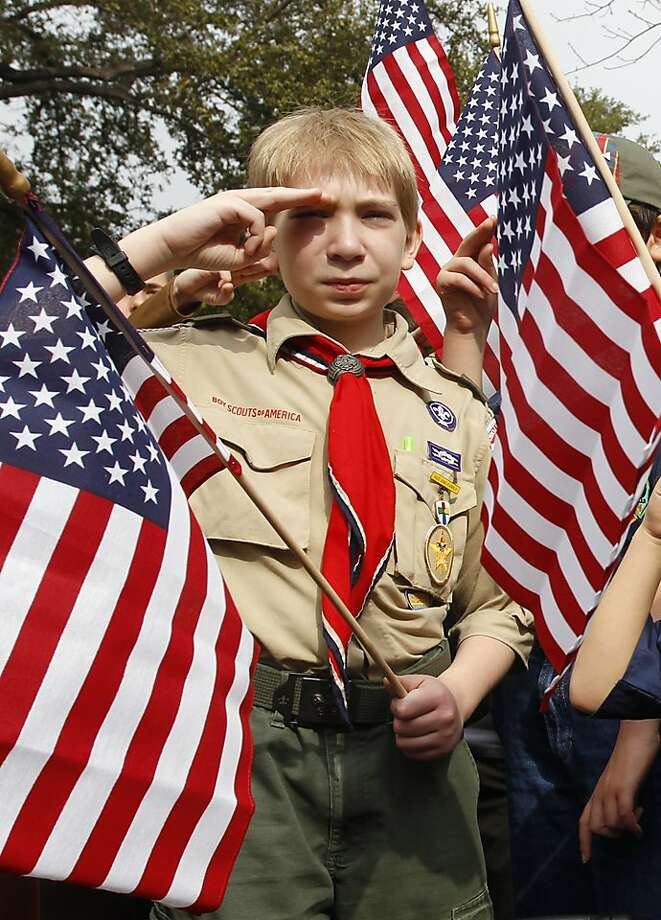 "(l-r) Joshua Kusterer, age 12 of Boy Scout Troop 226 in Plano, TX salutes as the crowd recites the pledge of allegiance during the ""Save Our Scouts"" Prayer Vigil and Rally in front of the Boy Scouts of America National Headquarters in Irving, TX Wednesday, February 6, 2013. (AP Photo/Richard Rodriguez) Photo: Richard W. Rodriguez, Associated Press"