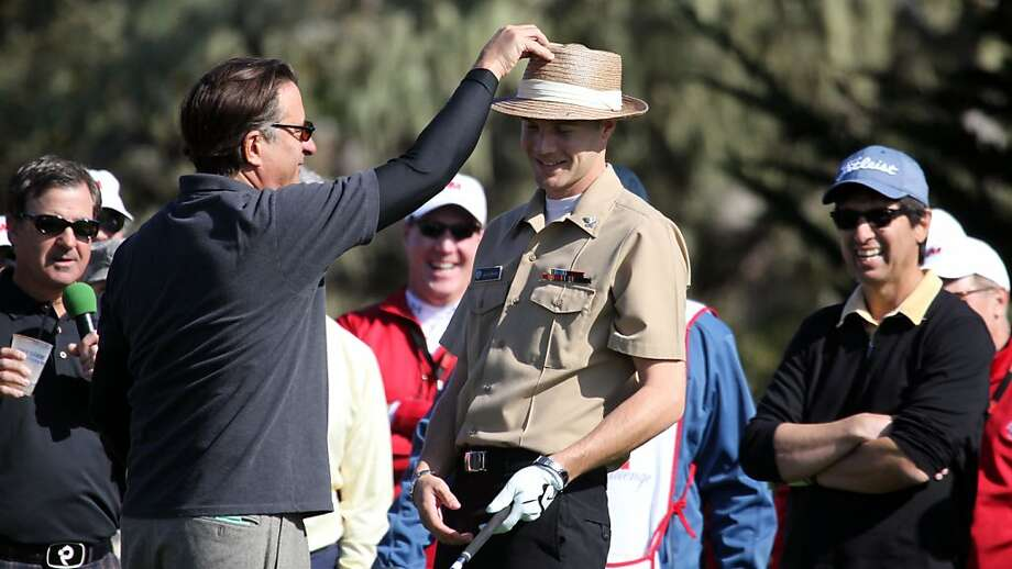 Actor Andy Garcia loans US Nany petty officer second glass Steven Quakenbush his hat during the 3M Celebrity Challenge shootout at the AT&T Pebble Beach National Pro-Am Golf Tournament on Tuesday, February 6th, 2013 in Pebble Beach, Calif. Quakenbush was invited to tee off with the Celebrities as they celebrated military appreciation day. Photo: Lance Iversen, The Chronicle