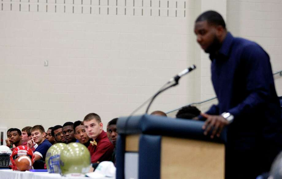 Fort Bend ISD students who committed to play football in college listen to former George Bush High School student and current Seattle Seahawk NFL player Russell Okung speak, who also played at Oklahoma State University. Photo: Johnny Hanson / © 2013  Houston Chronicle