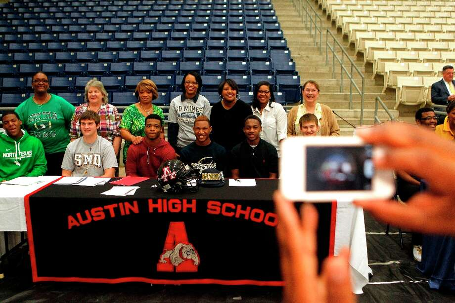Austin High School students who committed to play football in college get their picture taken with their mothers. Photo: Johnny Hanson / © 2013  Houston Chronicle