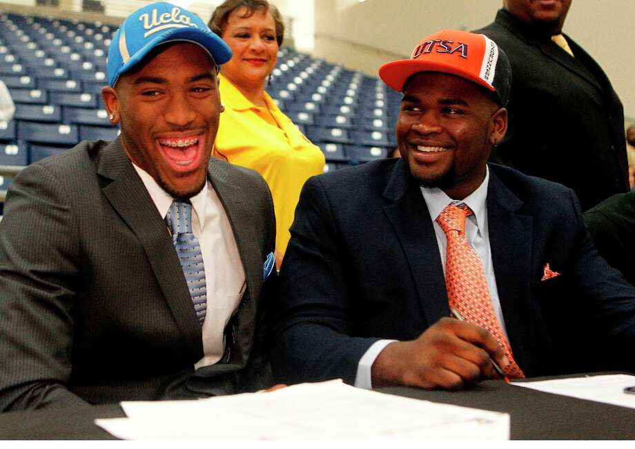 Fort Bend Marshall linebacker Deon Hollins Jr., left, who committed to play football at UCLA, shares a laugh with teammate Anthony Lee who committed to the University of Texas San Antonio. Photo: Johnny Hanson / © 2013  Houston Chronicle