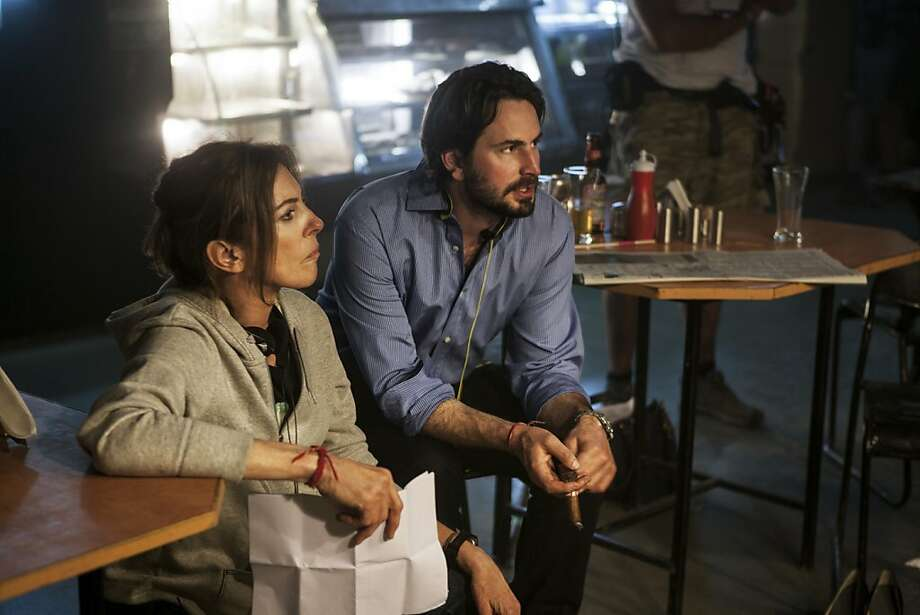 """Director-producer Kathryn Bigelow works with writer-producer Mark Boal on the set of """"Zero Dark Thirty."""" Photo: Jonathan Olley, Associated Press"""