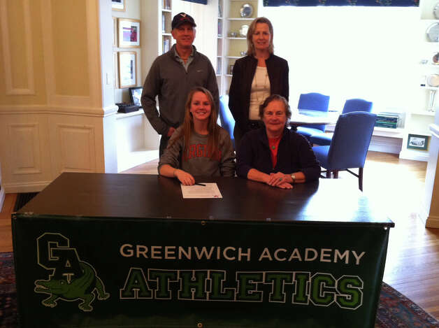 Greenwich Academy's Emilia Tapsall poses with parents and coach Angela Tammaro at Greenwich Academy for signing day. She will play field hockey at the University of Virginia. Photo: David Fierro/Staff Photographer