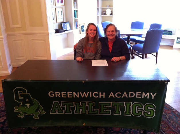 Greenwich Academy's Emilia Tapsall poses with coach Angela Tammaro at Greenwich Academy for signing day. She will play field hockey at the University of Virginia. Photo: Bob Luckey