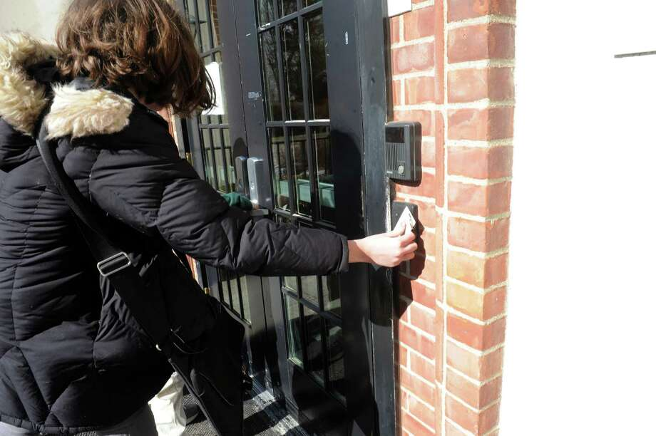 A student at Carmel Academy uses a key card to enter one of the school buildings in Carmel Academy, Greenwich, Conn., Wednesday, Feb. 3, 2013. Photo: Helen Neafsey / Greenwich Time