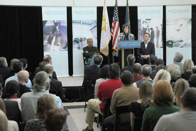 Deborah Onslow, at podium, CEO of the  Children's Museum of Science and Technology, addresses those gathered at an event at the College of Nanoscale Science and Engineering on Wednesday, Feb. 6, 2013 in Albany, NY.  The press conference was held to announce that the Children's Museum of Science and Technology will be integrated into CNSE.  Also pictured on stage is Alain Kaloyeros, left, senior vice president and CEO of CNSE and Paul Fahey, right, chairperson of the CMOST Board of Trustees.   (Paul Buckowski / Times Union) Photo: Paul Buckowski  / 10021061A