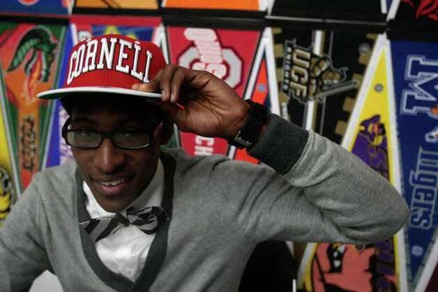 Robert Hatter of Westside High school shows off his Cornell University hat after signing his letter of intent to play basketball at Cornell University, Wednesday, February 6, 2013. Student athletes from Houston schools signed there letters of intent during the National Signing Day ceremony for Houston ISD at Delmar Field House. Photo: Billy Smith II, Chronicle