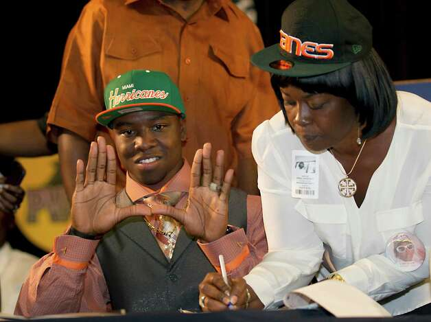 Miramar High's Jermaine Grace forms the U after announcing he was signing with the University of Miami in Miramar, Florida, Wednesday, February 6, 2013. (Joe Rimkus Jr./Miami Herald/MCT) Photo: Joe Rimkus Jr., McClatchy-Tribune News Service / Miami Herald