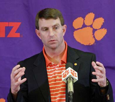 Clemson head football coach Dabo Swinney discusses the 2013 recruiting class that signed with the Tigers during a news conference on national signing day Wednesday, Feb. 6, 2013 in Clemson, S.C. (AP Photo/Anderson Independent-Mail, Mark Crammer) THE GREENVILLE NEWS OUT, SENECA NEWS OUT Photo: Mark Crammer, Associated Press / Anderson Independent-Mail