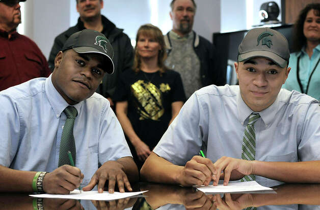 Cathedral Preparatory School seniors Delton Williams, left, and Damion Terry, attend a ceremonial letter-of-intent signing at the school in Erie, Pa., on Wednesday, Feb. 6, 2013. Earlier in the day, they signed their actual letters of intent to attend and play football at Michigan State. (AP Photo/Erie Times-News, Christopher Millette) MAGS OUT, TV OUT Photo: Christopher Millette, Associated Press / Erie Times-News