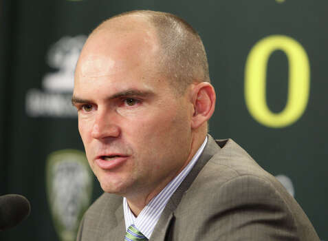 Oregon football coach Mark Helfrich talks about the NCAA college football team's recruits on signing day, in Eugene, Ore., on Wednesday, Feb. 6, 2013. (AP Photo/The Register-Guard, Chris Pietsch) Photo: Chris Pietsch, Associated Press / The Register-Guard