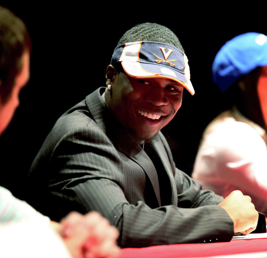 Bayside High School's Taquan Mizzell smiles at a news conference during which he signed his letter of intent to play NCAA college football for Virginia, Wednesday, Feb. 6, 2013, in Virginia Beach, Va. (AP Photo/The Virginian-Pilot, Ross Taylor)  MAGS OUT Photo: Ross Taylor, Associated Press / The Virginian-Pilot