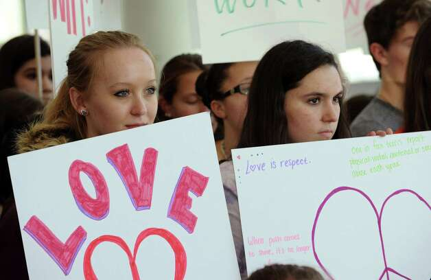 Area high school students hold signs during the launch of National Teen Dating Violence Awareness and Prevention Month at Stamford government center on Thursday, January 31, 2013. Photo: Lindsay Perry / Stamford Advocate