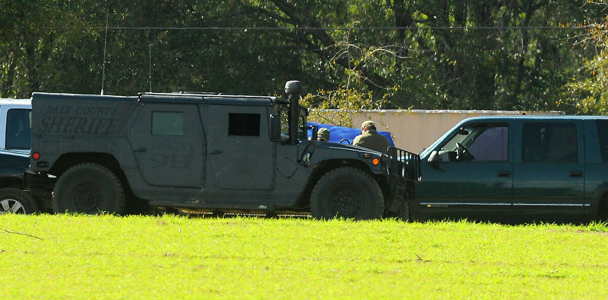 The FBI and other authorities continue to process the crime scene at the bunker where Jimmy Lee Dykes was killed after holding a 5-year-old boy captive for nearly a week in Midland City, Ala., Wednesday afternoon Feb. 6, 2013. The tent covering the bunker can be seen in the background. (AP Photo/AL.com,Joe Songer ) MAGS OUT