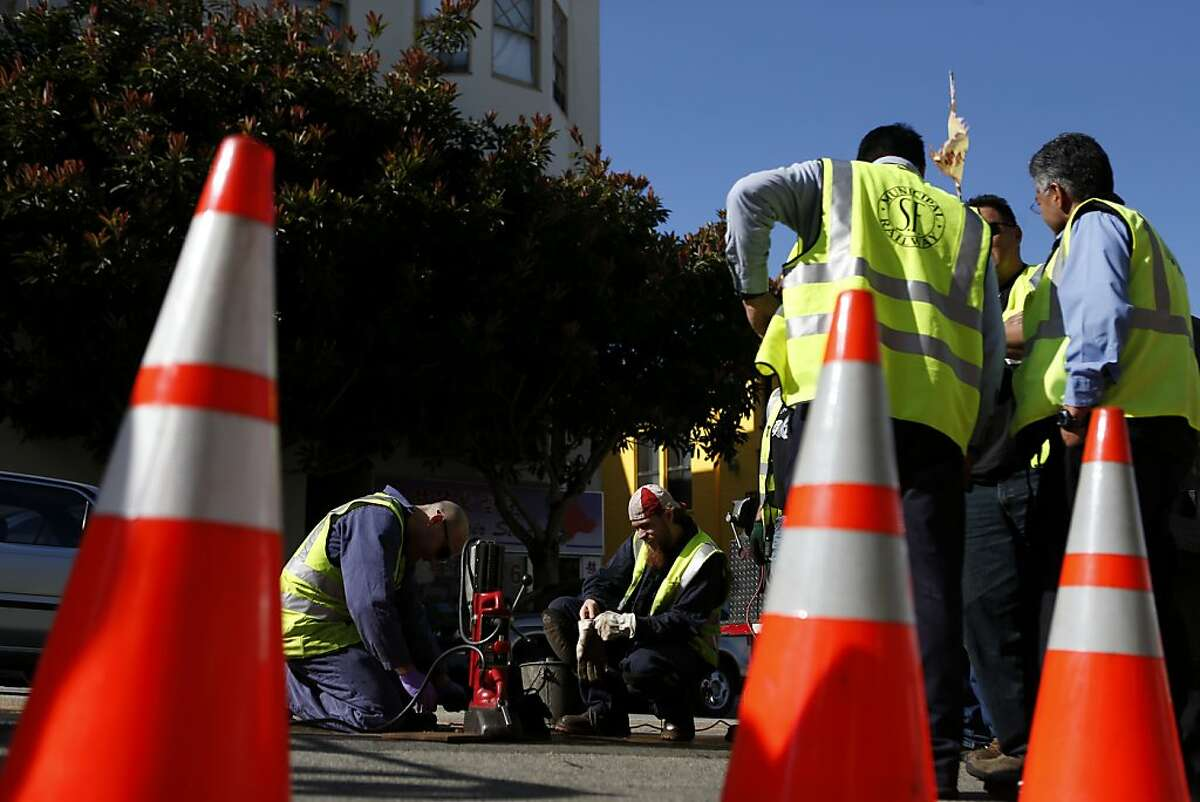 San Francisco Municipal Transit Authority personnel repair a portion of a track where an incident involving a cable car resulted in seven injuries near the intersection of Powell and Washington Streets on Wednesday, February 6, 2013 in San Francisco, Calif.