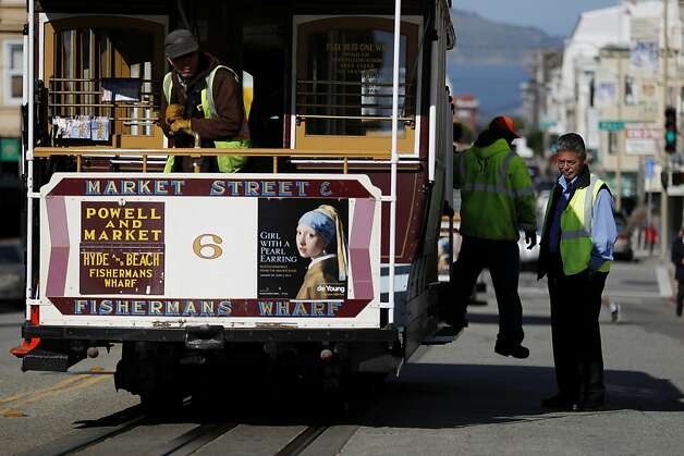 San Francisco Municipal Transit Authority personnel inspect a portion of a track where an incident involving a cable car resulted in seven injuries near the intersection of Powell and Washington Streets on Wednesday, February 6, 2013 in San Francisco, Calif. Photo: Beck Diefenbach, Special To The Chronicle
