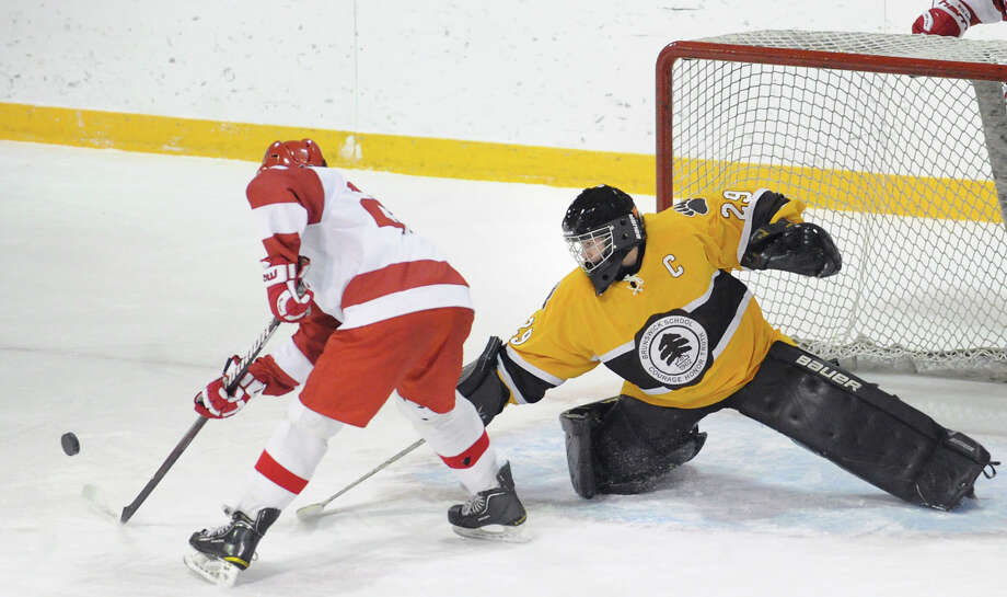 Brunswick goalie Gryphon Richardson, right, stick-checks the puck away from Gage Spolansky # 2 of Lawrenceville during the boys high school ice hockey game between Brunswick School and Lawrenceville at Brunswick School in Greenwich, Wednesday, Feb. 6, 2013. Photo: Bob Luckey / Greenwich Time