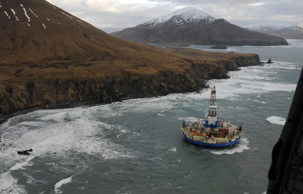 FILE - In this Jan. 3, 2013 file photo provided by the U.S. Coast Guard, two life rafts sit on the beach adjacent as the conical drilling unit Kulluk sits grounded 40 miles southwest of Kodiak City, Alaska. The united command overseeing the salvage of Royal Dutch Shell PLC drill barge that ran aground on a remote Alaska island will release minimal information on the vessel until an assessment is completed, a spokeswoman said. Shell?s drill vessel Kulluk, a round barge with a derrick in its center, ran aground New Year?s Eve on the southeast side of Sitkalidak Island near Kodiak Island.(AP Photo/U.S. Coast Guard, Petty Officer 2nd Class Zachary Painter, File)