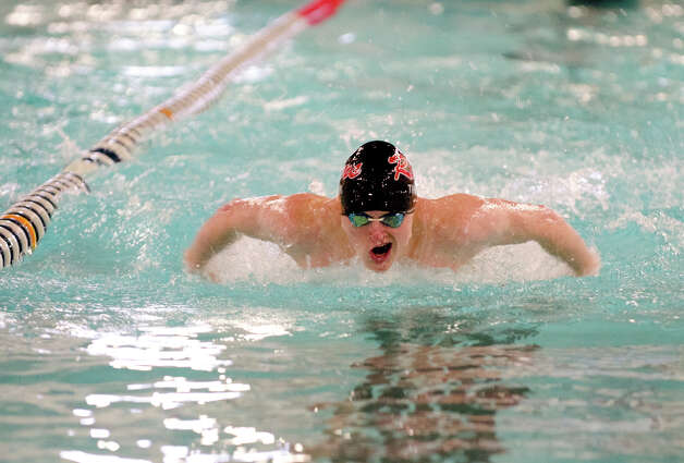 New Canaan's Ned Thunem swims the 100 Fly during the boys swim meet against Darien High School at the New Canaan YMCA on Wednesday, Feb. 6, 2013. Photo: Amy Mortensen / Connecticut Post Freelance