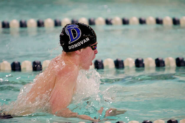 Darien's Colin Donovan swims the 100 Breast during the boys swim meet against New Canaan High School at the New Canaan YMCA on Wednesday, Feb. 6, 2013. Photo: Amy Mortensen / Connecticut Post Freelance