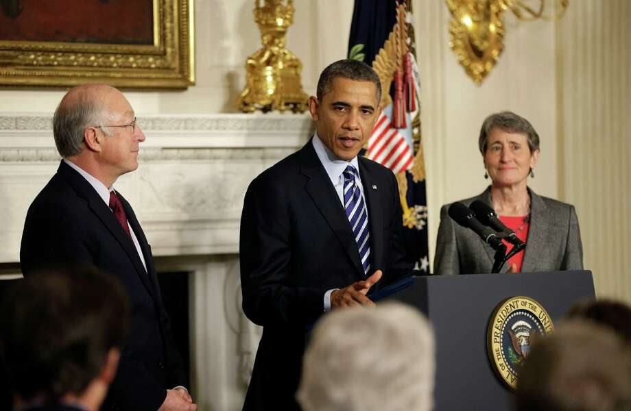 President Barack Obama announces he is nominating REI CEO Sally Jewell, right, as the next interior secretary replacing outgoing Interior Secretary Ken Salazar, left, Wednesday, Feb. 6, 2013, in the State Dining Room of the White House in Washington. (AP Photo/Pablo Martinez Monsivais) Photo: Pablo Martinez Monsivais, STF / AP