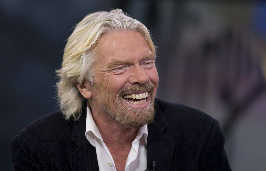 Richard Branson, chairman and founder of Virgin Group Ltd., laughs during an interview in New York, U.S., on Thursday, Dec. 6, 2012. Branson's Virgin Trains was handed a deal to run Britain's premier rail route for two more years on the day a government-backed probe found that a decision to strip it of the contract was based on faulty calculations. Photographer: Scott Eells Richard Branson, chairman and founder of Virgin Group Ltd., laughs during an interview in New York, U.S., on Thursday, Dec. 6, 2012. Branson's Virgin Trains was handed a deal to run Britain's premier rail route for two more years on the day a government-backed probe found that a decision to strip it of the contract was based on faulty calculations. Photographer: Scott Eells/Bloomberg *** Local Caption *** Richard Branson Photo: Scott Eells, Bloomberg