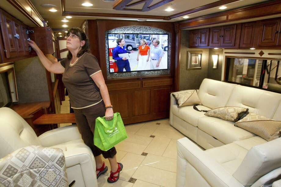 Recreational vehicles, like the Winnebago Tour 42GD at the Houston RV Show at Reliant Center, are saving two to three feet of cabinet space with flat-screen TVs, allowing more room for such items as L-shaped sofas. Photo: Brett Coomer / Houston Chronicle