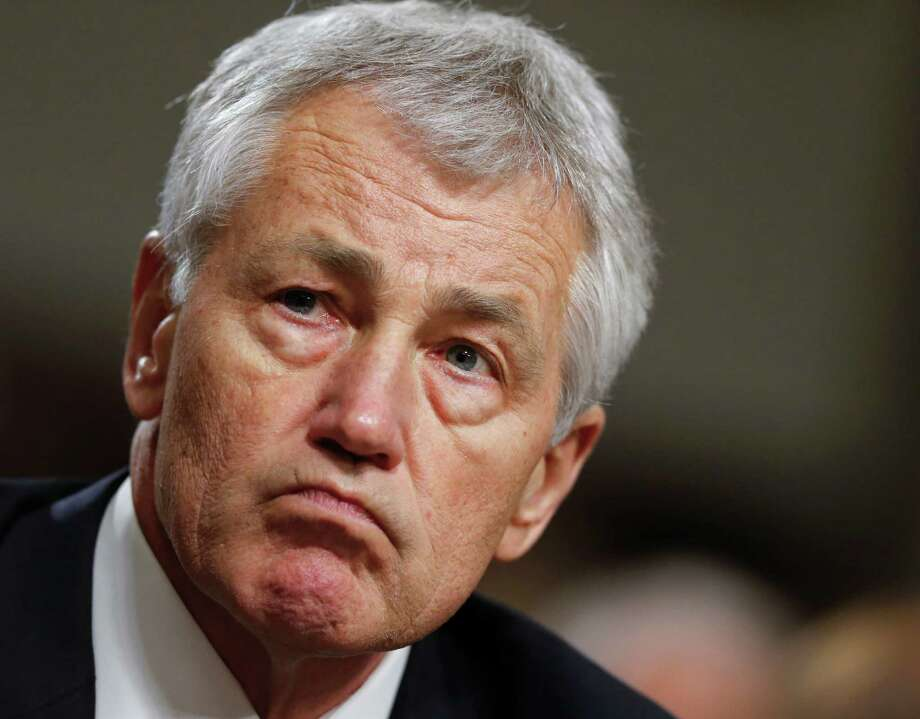FILE - In this Jan. 31, 2013 file photo, former Nebraska Sen. Chuck Hagel testifies on Capitol Hill in Washington before the Senate Armed Services Committee's confirmation hearing. Countering the Republican-led opposition to President Barack Obama's nominee for defense secretary is a less flashy but powerful constituency _ military veterans. Longstanding veterans' organizations have praised Hagel, a twice-wounded combat veteran of Vietnam and deputy administrator in President Ronald Reagan's Veterans Administration. (AP Photo/J. Scott Applewhite, File) Photo: J. Scott Applewhite