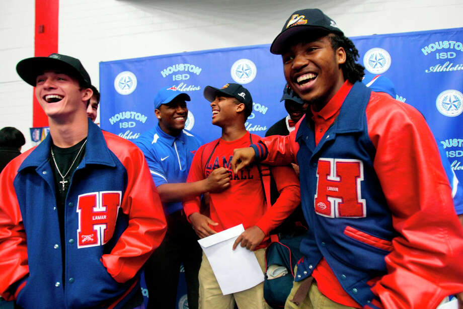 (l-r) Lamar High school student athletes celebrate signing there letters of intent ,Will Foreman signed with Texas Christian University, Zelt Minor with Southern Methodist University , Cravon Rogers Jr with Morgan State, Gregory Gibson with Morgan State during the National Signing Day ceremony for Houston ISD at Delmar Field House. Photo: Billy Smith II, Chronicle