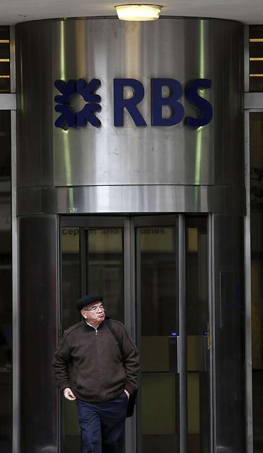 (FILES) In this file picture taken on January 30, 2012 a man leaves the Royal Bank of Scotland (RBS) in London. Royal Bank of Scotland on February 6, 2013 said fines from British and US financial regulators over its role in the Libor rate-rigging scandal totalled USD $612 million.   AFP PHOTO / JUSTIN TALLISJUSTIN TALLIS/AFP/Getty Images Photo: Justin Tallis, AFP/Getty Images