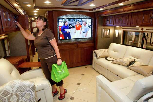 Beth Land, of Brookeland, Texas, looks at the inside of a Winnebago Tour 42GD at the Houston RV Show at Reliant Center Wednesday, Feb. 6, 2013, in Houston. Photo: Brett Coomer, Houston Chronicle / © 2013 Houston Chronicle