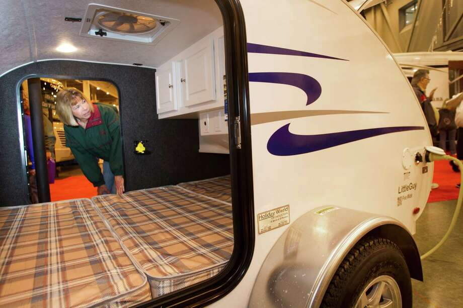 Karen Sheehan, of Katy, looks inside a Little Guy teardrop camper/trailer at the Houston RV Show at Reliant Center Wednesday, Feb. 6, 2013, in Houston. Photo: Brett Coomer, Houston Chronicle / © 2013 Houston Chronicle