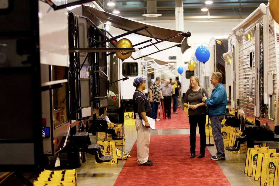 Sales representatives talk to visitors at the Houston RV Show at Reliant Center Wednesday, Feb. 6, 2013, in Houston. Photo: Brett Coomer, Houston Chronicle / © 2013 Houston Chronicle