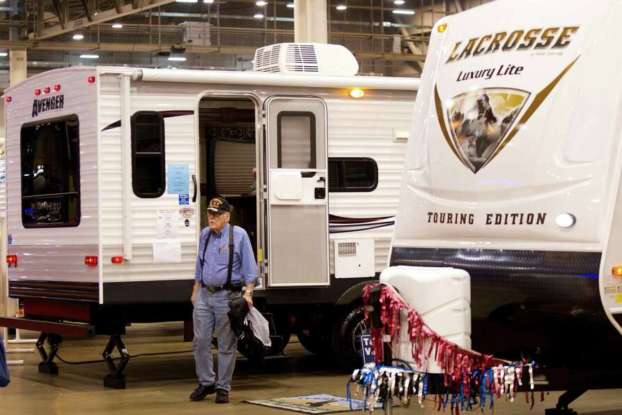 Don Goodfellow walks past RVs on display at the Houston RV Show at Reliant Center Wednesday, Feb. 6,