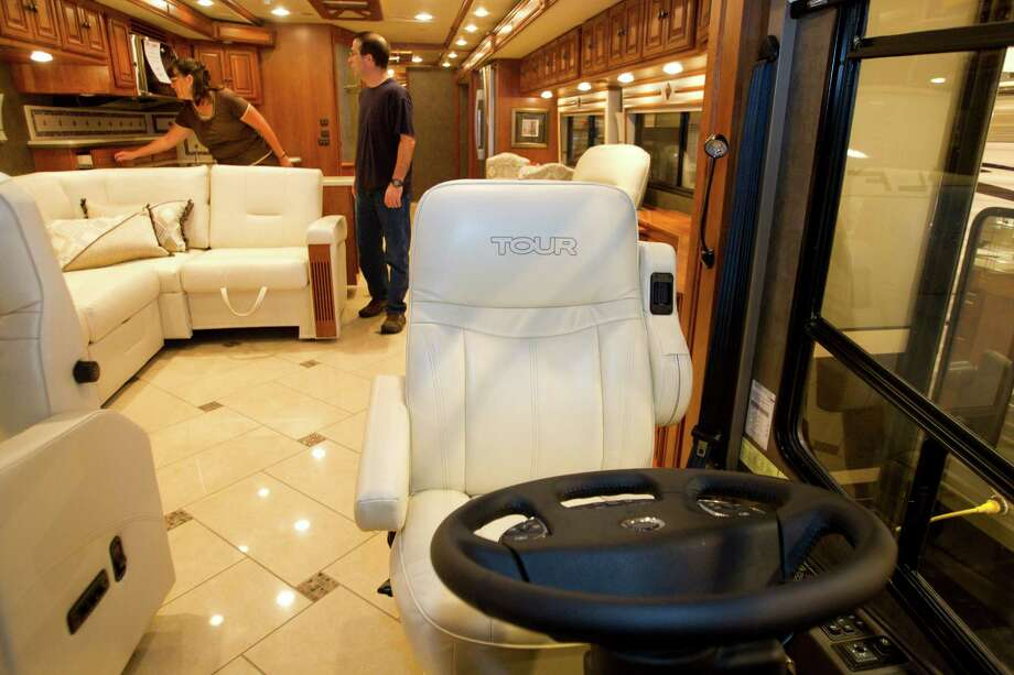 Beth Land, left, and Bob Land, of Brookeland, Texas, look at the inside of a Winnebago Tour 42GD at the Houston RV Show at Reliant Center Wednesday, Feb. 6, 2013, in Houston. Photo: Brett Coomer, Houston Chronicle / © 2013 Houston Chronicle