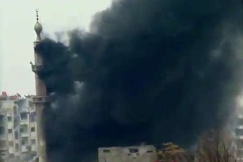 This image taken from video obtained from Ugarit News, which has been authenticated based on its contents and other AP reporting, shows smoke and fire billowing from an explosion in Damascus, Syria, Wednesday, Feb. 6, 2013. Heavy fighting erupted in Damascus Wednesday as government forces tried to hold back a new rebel effort to push the civil war into the heart of the Syrian capital, activists said.(AP Photo/Ugarit News via AP video) Photo: Anonymous