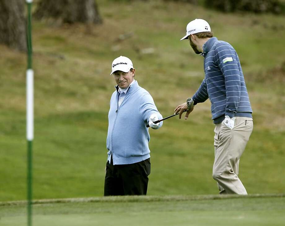 Wayne Gretzky (left) practices at Spyglass Hill with PGA Tour star Dustin Johnson, boyfriend of Gretzky's daughter Paulina. Photo: Michael Macor, The Chronicle