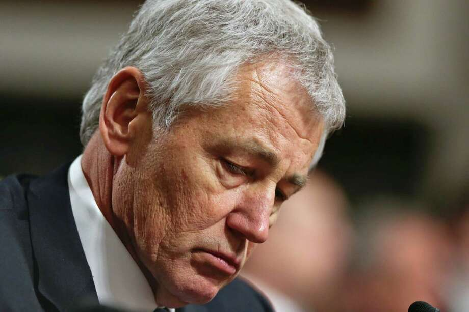 FILE - In this Jan. 31, 2013, file photo  Republican Chuck Hagel, a former two-term GOP senator from Nebraska and President Obama's choice for Defense Secretary, testifies before the Senate Armed Services Committee during his confirmation hearing on Capitol Hill in Washington. A Senate panel on Wednesday, Feb. 6, 2013, abruptly postponed a vote on Chuck Hagel's nomination to be defense secretary amid Republican demands for more information from President Barack Obama's nominee about his paid speeches and business dealings (AP Photo/J. Scott Applewhite, File) Photo: J. Scott Applewhite