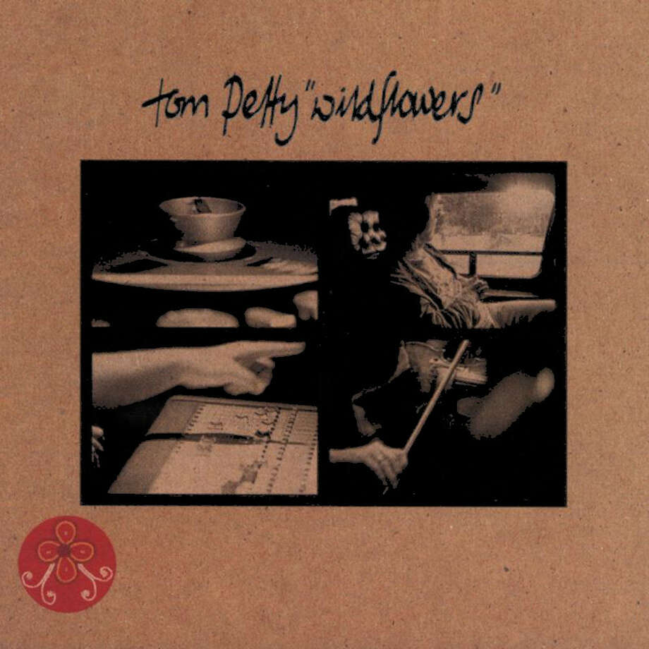 """Tom Petty – """"Wildflowers:""""This 1994 album included """"You Don't Know How It Feels,"""" """"Wildflowers,"""" and """"You Wreck Me."""" Remember when MTV played a censored version """"You Don't Know How it Feels"""" covering up the line """"Let's roll another joint?"""" (Album cover)"""