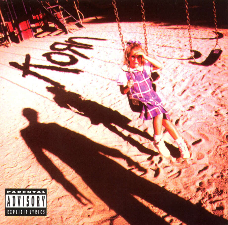 "Korn – ""Korn:""This influential debut album influenced metal music and bands including Slipknot and Limp Bizkit. (Album cover)"