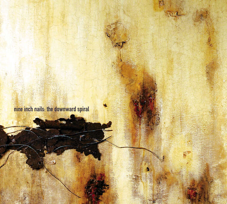 "Nine Inch Nails – ""The Downward Spiral:"" This was the band's second studio album that included ""Closer"" and reached No. 2 on the Billboard 200 Albums chart. It has sold more than 4 million copies in the United States. (Album cover)"