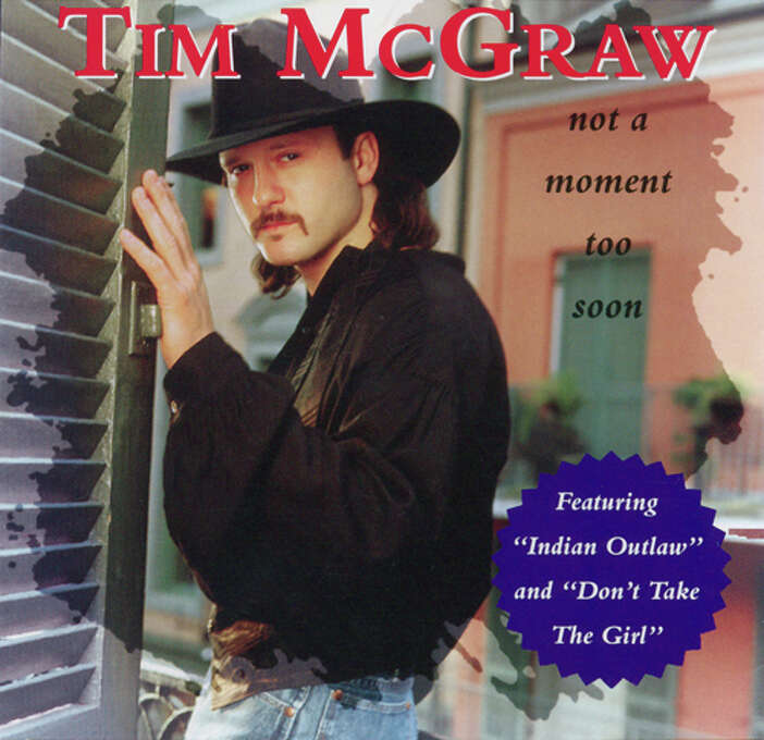 """Tim McGraw – """"Not a Moment Too Soon:"""" This second studio album by the modern country legend included """"Indian Outlaw,"""" and """"Don't Take the Girl."""" Chances are if you're a big-time country fan you know someone who can sing the words to that last ballad, which also hit the pop charts. (Album cover)"""