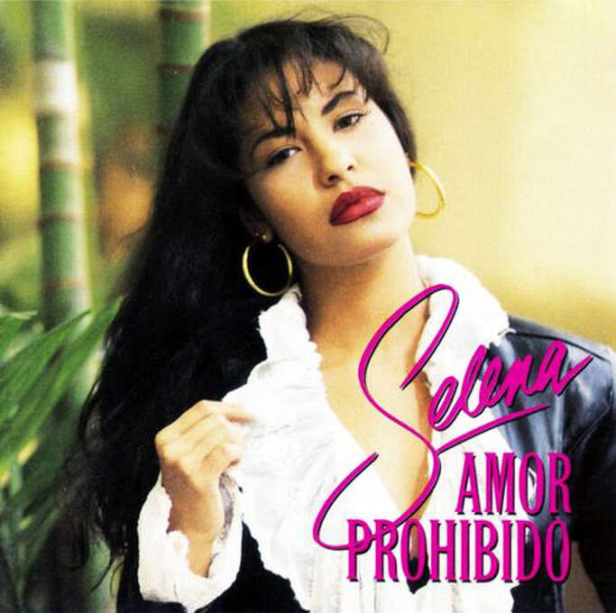 """Selena """"Amor Prohibido:"""" The album debuted at No. 1 on Billboard's Latin Regional Mexican Albums and Top Latin Albums chart, and went on to sell more than 2 million copies in the United States. Selena was shot to death the in March 1995 at age 23. (Album cover)"""