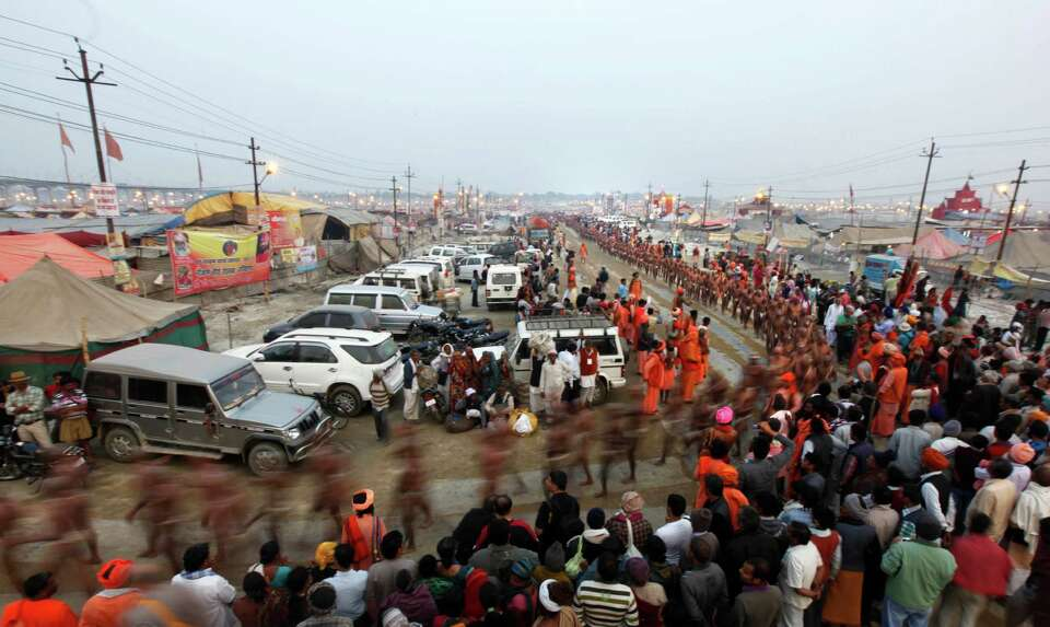 Hindu holy men of the Juna Akhara sect return after a rituals that are believed to rid them of all t