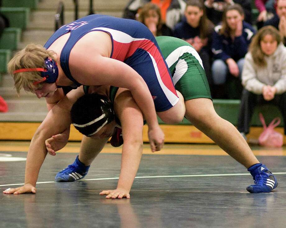 New Fairfield's Shawn Graves, top, pinned  New Milford's Jomar Orejuela in the 285-pound weight class Wednesday night at New Milford High School. Photo: Barry Horn / The News-Times Freelance